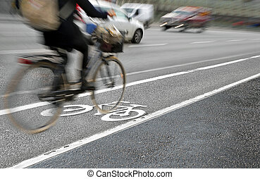cyclist in bicycle lane - Female cyclist in bicycle lane on ...