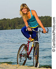 Female cyclist posing outdoors