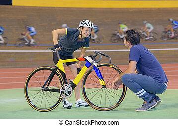 female cyclist training on a velodrome