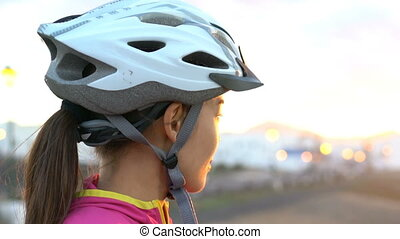 Female Cyclist With Bike Helmet Looking At Sunset - Portrait Of Sporty Woman