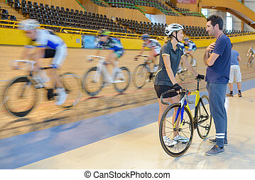 female cyclists in a velodrome