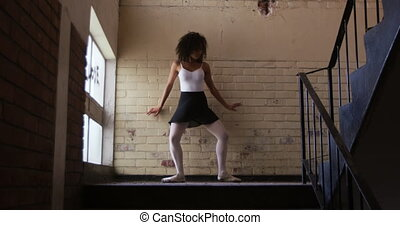 Female dancer in an empty warehouse - Low angle front view ...