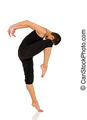 female dancer practising in studio