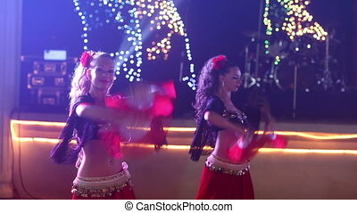 female dancers dancing in spanish costume at indian wedding party