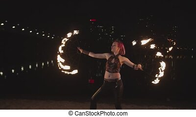 Female dancing with flaming fans during firshow - Pretty...
