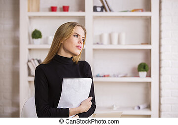 Female daydreaming in office