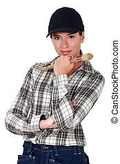 Female decorator holding brush