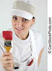 Female decorator holding paint brush
