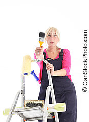Female decorator on a ladder