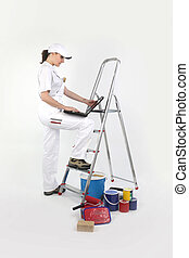 Female decorator with a laptop