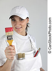 Female decorator with a paint brush