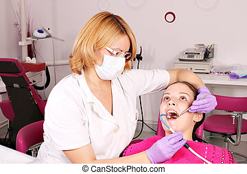 female dentist and girl patient dental exam