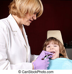 female dentist and little girl patient