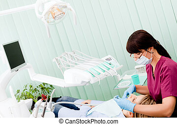 Female dentist working