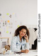 Female designer at her office