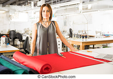 Female designer in a textile factory