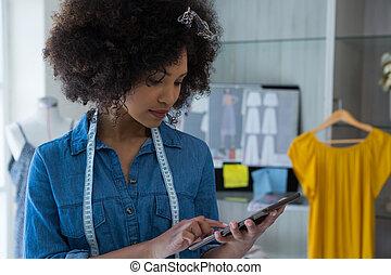 Female designer using digital tablet