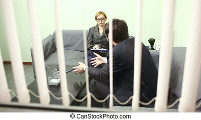 female director talking with the employee. report to the...