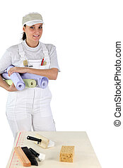 female diy enthusiast holding wallpaper rolls