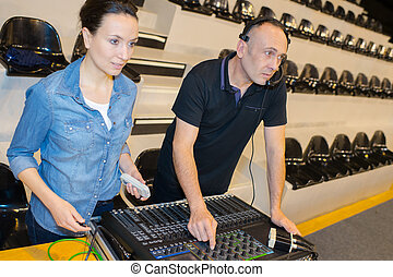 female dj live working with colleague