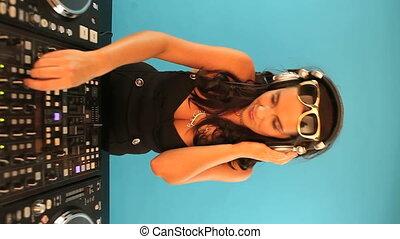 Female DJ waving her hands