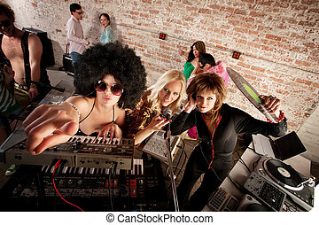 1970s Disco Music Party - Female DJs checking out the scene...