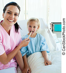 Female doctor checking her patient\'s throat