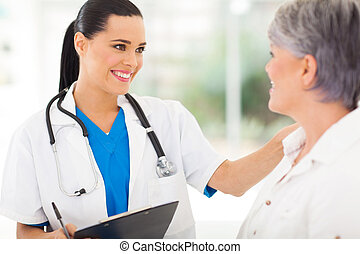 female doctor comforting middle aged patient - friendly...