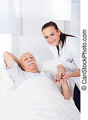 Female Doctor Consoling Senior Man