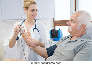 female doctor consulting with senior patient