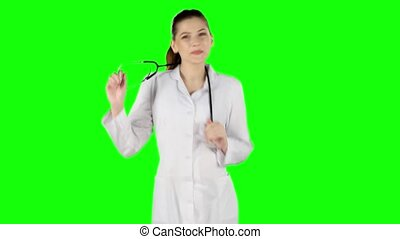 Female doctor dancing with stethoscope. Green screen