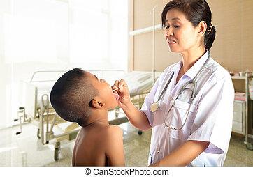 doctor examines a boy