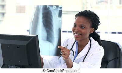 Female doctor examining a chest X-ray