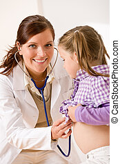 Female doctor examining child with stethoscope