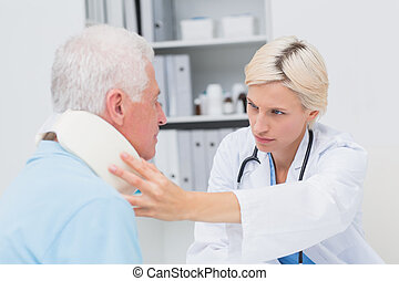 Female doctor examining patient