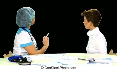 Female doctor explaining diagnosis to her female patient. Alpha channel.