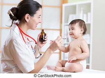 doctor giving medicament to kid with a spoon, hospital