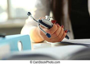 Female doctor hand hold phonendoscope in medical