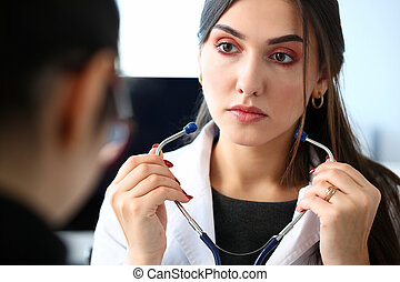 Female doctor hands holding stethoscope in