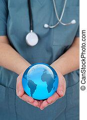 World Health - Female Doctor Holding A World Globe In Her...