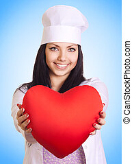 Female doctor holding heart on blue background