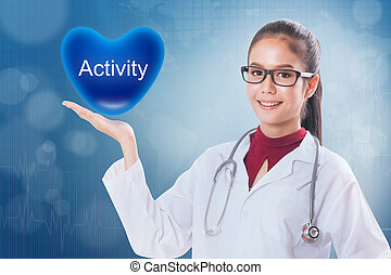 Female doctor holding heart with activity sign on medical background.