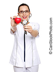 Female doctor holding red heart in hand