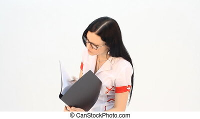 Female doctor in glasses with clipb
