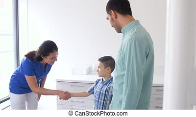 female doctor meeting family at dental clinic