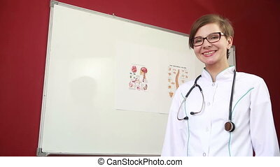 Female doctor, nurse holding the pills. Portrait of a beautiful happy female doctor standing in the hospital