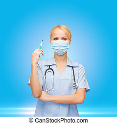 female doctor or nurse in mask holding syringe - healthcare ...