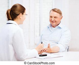 female doctor or nurse measuring blood sugar value -...