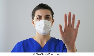 female doctor or nurse showing clean hand - hygiene, ...