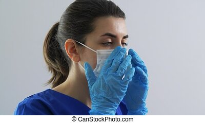 female doctor or nurse wearing medical face mask - health, ...
